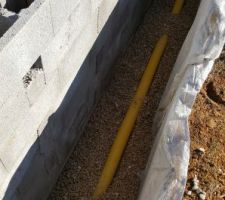 Raccord du drain a l'évacuation des eau de pluie (terrain en pente)
