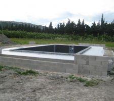 Dalle en beton pour la pose de l'abri
