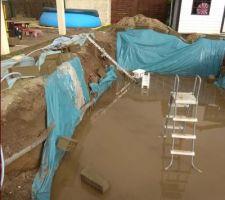 Mur qui tombe et 15cm d'eau sur la dalle..