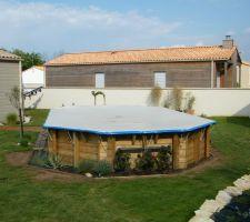 Bache d'hivernage   mis ene forme du tour de piscine pour plantation